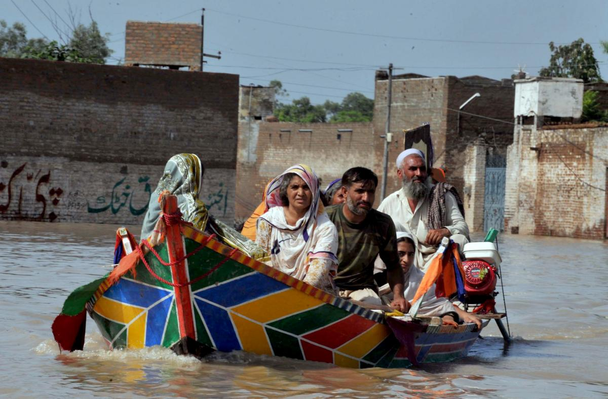 Paddling away from floods in Pakistan in 2010; flash flooding in Karachi killed more than a dozen last week. Flickr/IRIN News