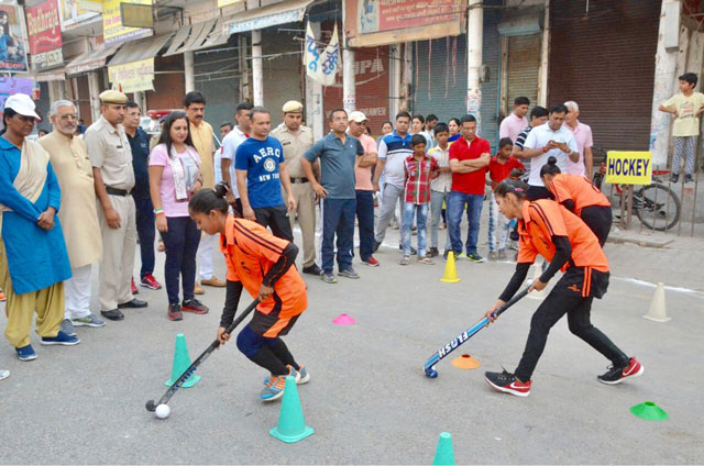 To promote gender equality, women and girls participated in different sporting events, including hockey. Photo by Deputy Commissioners Office, Jhajjar, India