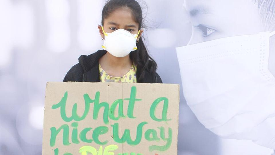 A child at the protest against growing air pollution in Gurugram, at Leisure Valley Park, Sector 29, in Gurugram, on Sunday, November 17, 2019. (Yogendra Kumar/HT PHOTO)