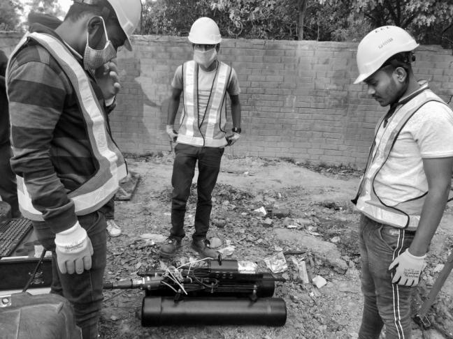 Fluid Robotics employees with robot during deployment