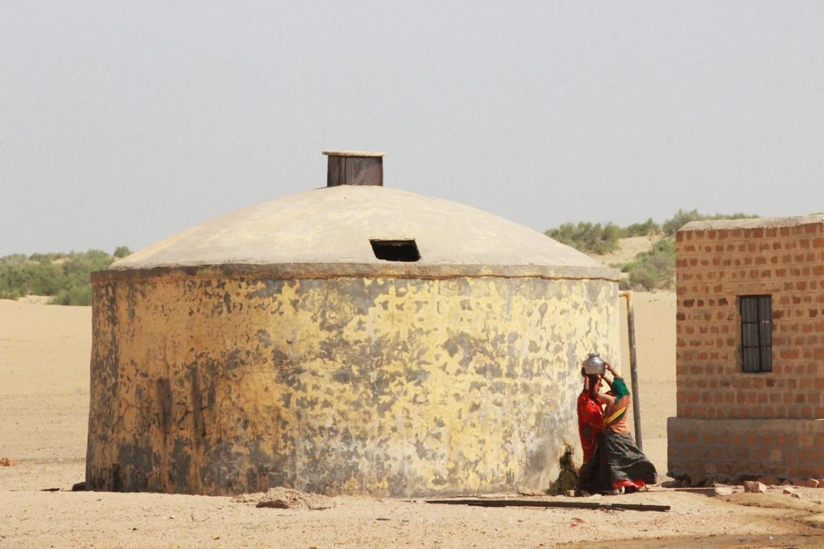 Women collecting water from a Ground Level Reservoir (GLR)