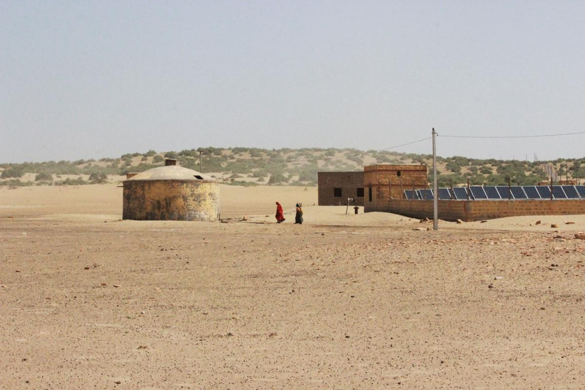 Women on their way to collect water from a GLR. Water supply here is powered by a solar unit.