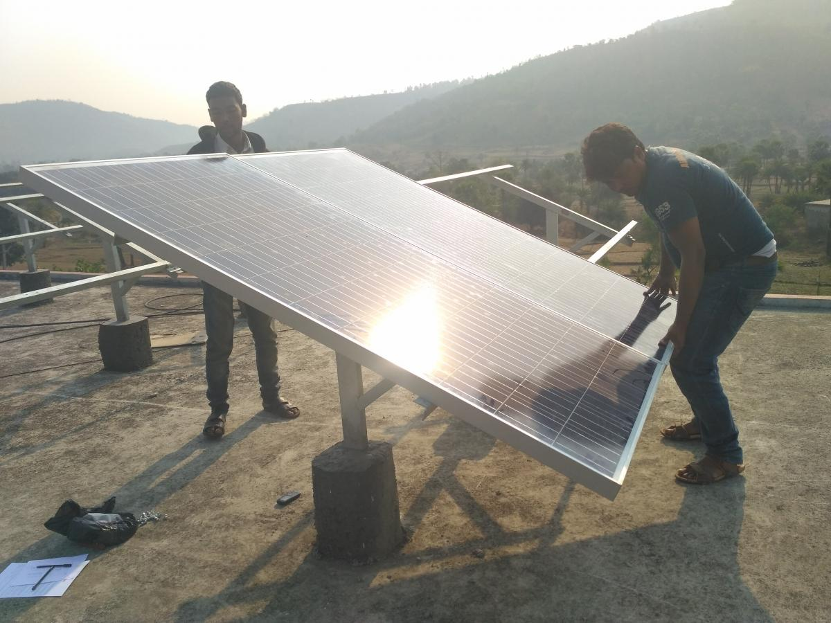 Figure 2: Team at work installing the 15kWp solar PV system on the roof of the hospital in 2017